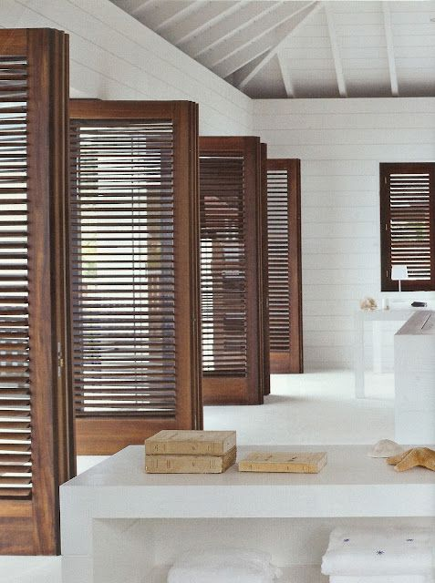 louvered doors lend an inviting casual comfort to any space - the rest of this space is austere
