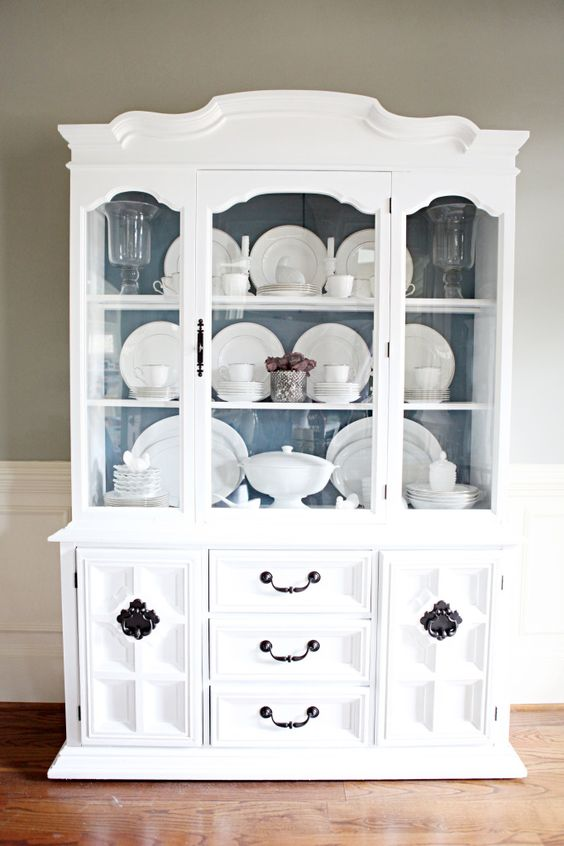 Love how Katie Bower updated this very traditional china cabinet and LOVE the styling!