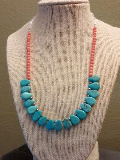 Turquoise teardrops on coral with silver sparkle.