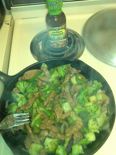 Beef and broccoli stir with onions peppers.