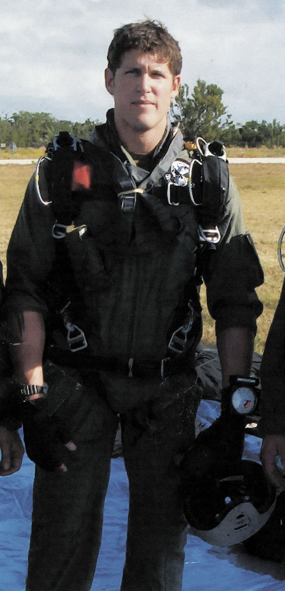 Petty Officer First Class Jason Workman, age 31, had ...