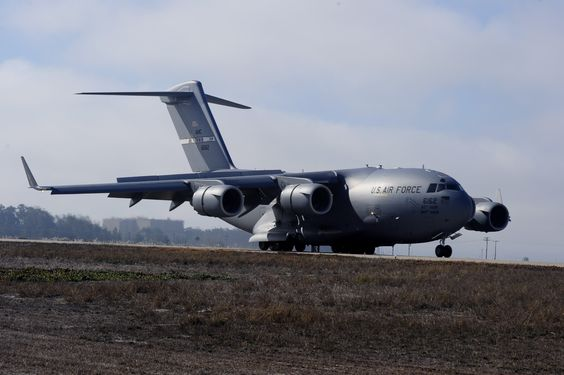 A C-17 Globemaster III from the 60th Air Mobility Wing taxis the runway, Sept. 15, 2014, Vandenberg Air Force Base, California. The aircraft made the trip from Travis Air Force Base, California, for an Air Combat Operations Training Exercise, held by Airmen with the 570th Contingency Response Group, Sept. 15 through 17. (U.S. Air Force photo/Senior Airman Shane Phipps)