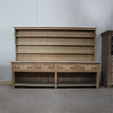 a period English dresser with rack above four drawers and potboard