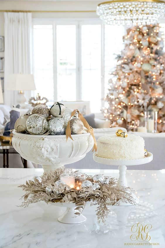 Elegant white Christmas decor in a beautifully decorated kitchen and living space by Randi Garrett Design.