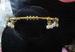 "New Listing Started goldtone bangle with balls/faux pearl beads new condition 9.25""long 2.75""across £1.00"