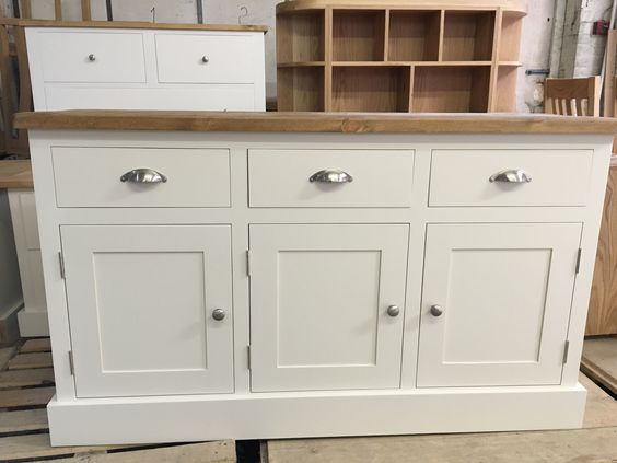 Painted sideboard with a rustic pine top.