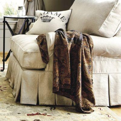 Ballard's slipcovered chair with pleats on bottom