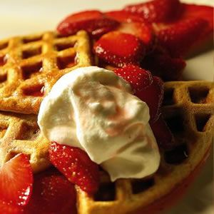 Traditional waffles are a butter-laden, high-carb indulgence, but they make the transition to good...
