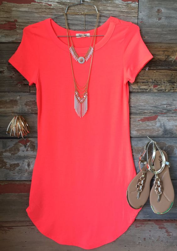 The Fun in the Sun Tunic Dress in Neon Coral is comfy, fitted, and oh so fabulous! A great basic that can be dressed up or down! (www.privityboutique.com) #neoncoral #tshirt #dress #fitted #stretchy #adorable: