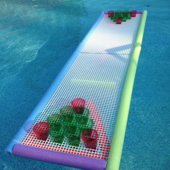Floating Beer Pong Table - seven noodles, some zip ties, two fluorescent light covers and viola.