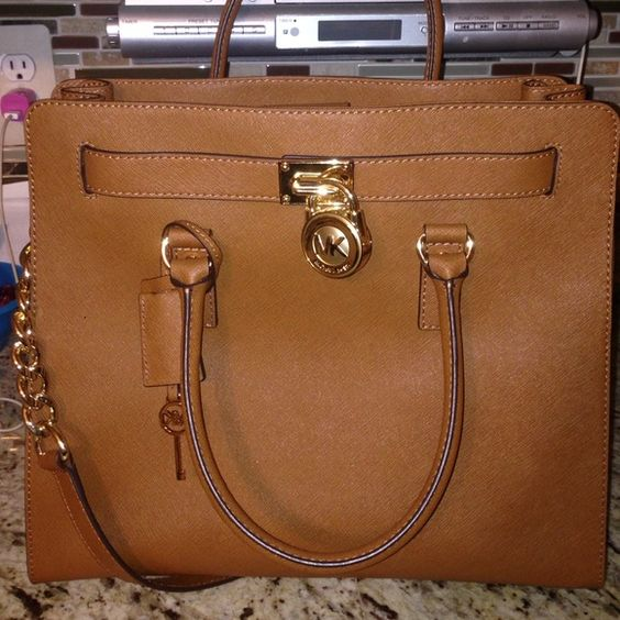 Michael kors Hamilton tote Brand new bag used once. Still completely stiff and in perfect condition ... Has a short strap and a long strap no rips scratches or tears whatsoever. :) offers are welcome!! Michael Kors Bags Totes