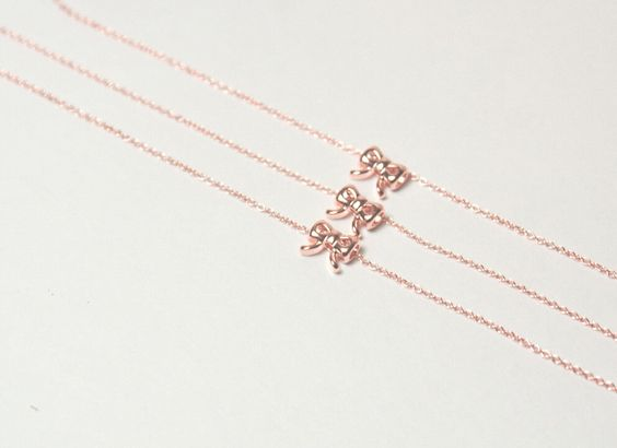 Rose gold bow necklace set. three sisters gift,bowtie necklace,ribbon necklace. rosegold jewelry.Bridesmaids gifts,Bridesmaids Presents Set. by ElseCreation on Etsy https://www.etsy.com/listing/197115430/rose-gold-bow-necklace-set-three-sisters