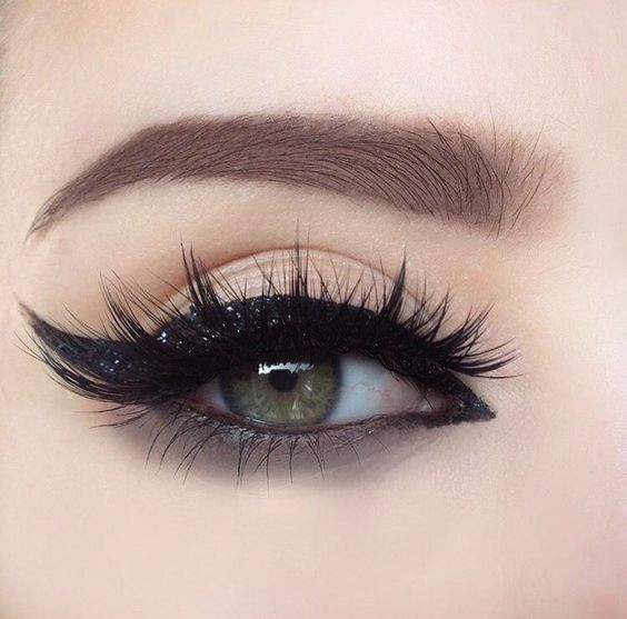 Slaying that glitter cat eye @femmeglamour_ Uneven eyelids? Too much redness? Apply concealer before applying your eye makeup to your lids to get rid of any blotchyness. #cateye #eyeliner #glitter