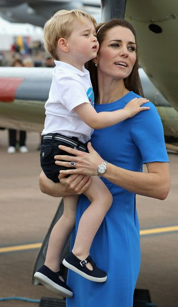 Kate Middleton Photos - Catherine, Duchess of Cambridge and Prince George during a visit to the Royal International Air Tattoo at RAF Fairford on July 8, 2016 in Fairford, England. - The Duke & Duchess of Cambridge Visit the Royal International Air Tattoo: