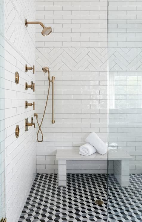 A Seamless Glass Shower Door Opens To Black And White Geometric Floor Tiles Fixed Beneath A Sub Beautiful Bathroom Designs Bathroom Shower Tile Doorless Shower
