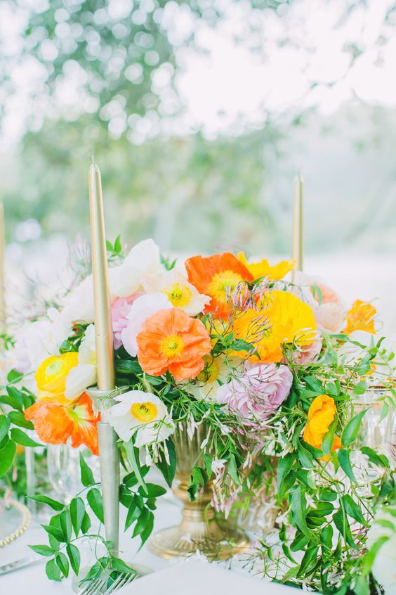 Cheerful springtime centerpiece with Poppies, Ranunculus and Garden Roses. #wedding #flowers