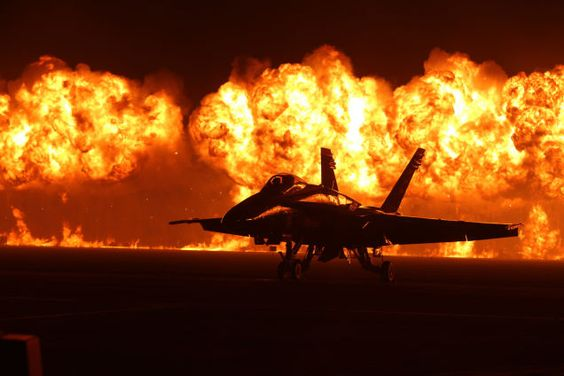 Spectacular photo of an F-18 against a huge wall of fire