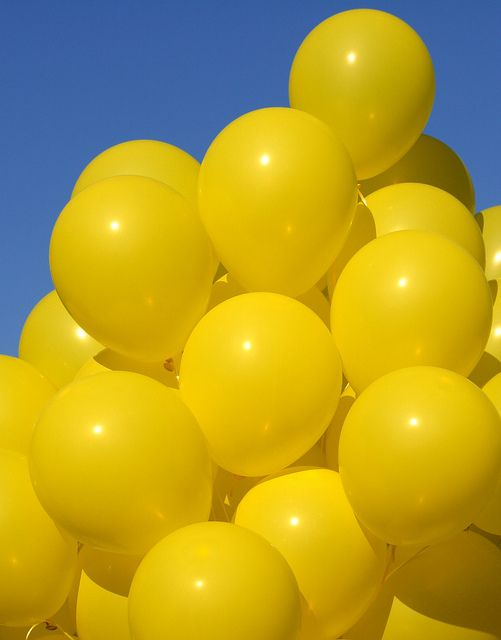Carry yellow balloons around with me all day, giving them away!!!