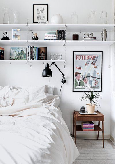 home, interior, white, shelving, bedding, vintage poster, lamp, storage: