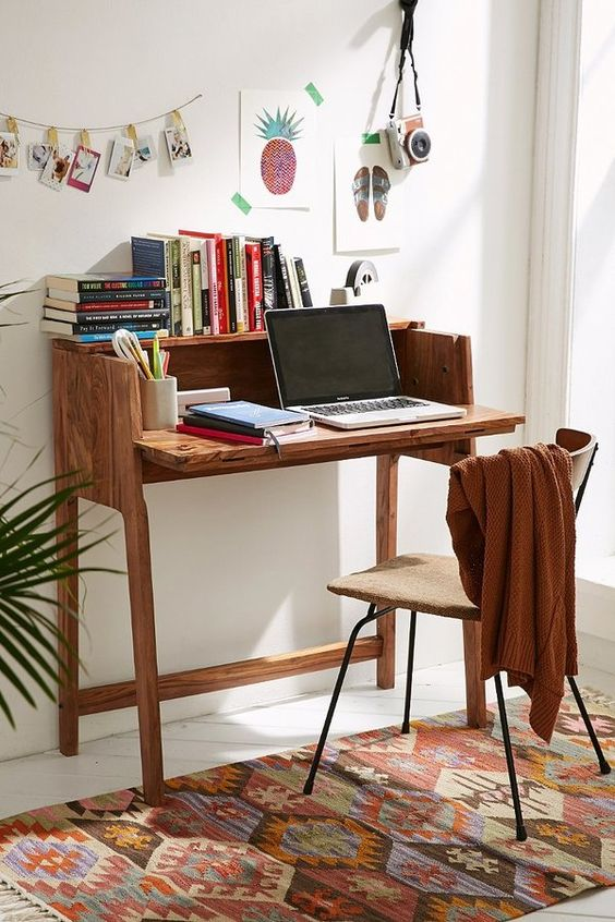 "Essential foldout desk to optimize storage + work space in any apartment or small living area. Solid + durable design that folds out when you need it + tucks away when you don't. Features secret storage compartments that lift to reveal plenty of room for pencils, paper + more. Modern + rustic touch to any living space. Content + Care Wood Wipe clean Imported Size Folded up: 13""l x 35""w x 35""h Folded out: 20""l x 35""w x 35""h:"