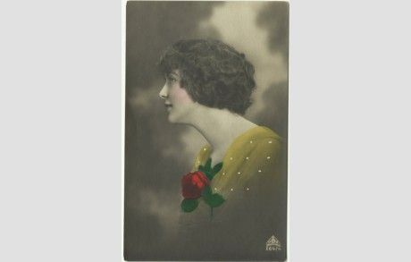 Antique Postcard RPPC Beautiful Dutch Woman Wearing a Red Rose - 1918