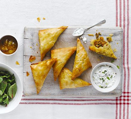 These Indian pastry parcels are freezable, so make a batch and keep some for a rainy day. Serve with cooling raita and crisp salad
