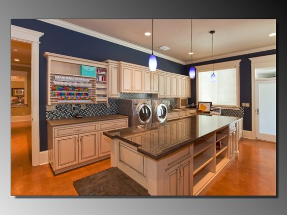 Amazing laundry/craft room. The house also has multiple laundry and craft rooms– including a gift wrapping station– a master suite and a professional grade kitchen.  Construction took 18 months. Rush Custom Homes is based in Gig Harbor.