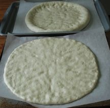 This is a lovely pizza dough - silky and smooth.  It came together perfectly with my stand mixer and dough hook.  I parbaked it on a pizza stone for 5-6 minutes and froze it for Friday pizza night!  One crust should be enough for me and Matt, especially if we have a salad or something with it.  Thanks, www.favoritefreezerfoods.com!
