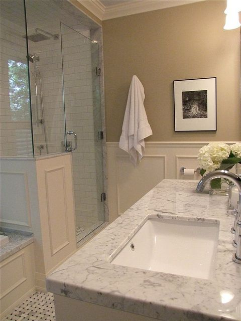Carrara marble tub deck and basket weave floor shower and for Master bathroom countertops