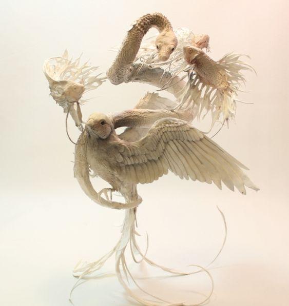 Sculpture : Des poissons, un oiseau et un serpent by Ellen Jewett
