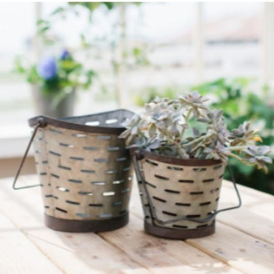 Inspired by vintage olive buckets that are used to gather and wash the fruit during the harvest season, these Metal Olive Buckets will make a great display in a