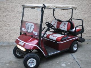 """Roll Tide Roll! Check out this beautiful """"Alabama"""" color schemed electric golf cart for sale. Show off your school spirit tailgating with this 36 volt Ezgo Txt cart. Equipped with a front windshield with a very nice see thru murial. As well as a weather enclosure and some really sharp graphics per our own Bob Hoffman!"""