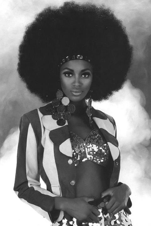 The 70's were a crazy time in fashion; however the look a black woman sporting her natural hair is powerful.