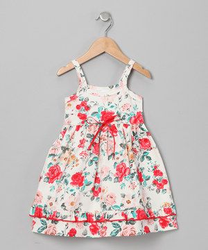This versatile dress boasts a pair of pretty prints, charming ribbon bow and playful ruffle trim. The soft cotton design keeps little ones comfy, cozy and content. Size note: Infant sizes runs small. Mad Sky recommends ordering one size up.