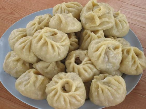 Buuz - a type of Mongolian steamed dumpling filled with minced mutton or beef, which is flavored with onion or garlic and salted. Mashed potato, cabbage, or rice may be added as well.