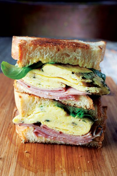 // ham and egg breakfast sandwich with lemon curd and goat cheese
