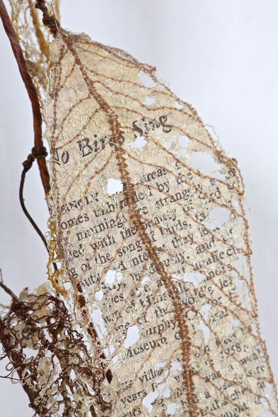 "Lisa Kokin, ""Fauxliage: No Birds Sing"", 2011. Thread, wire, page fragments from Silent Spring (1962) by Rachel Carson 70 x 24 x 8 in.:"