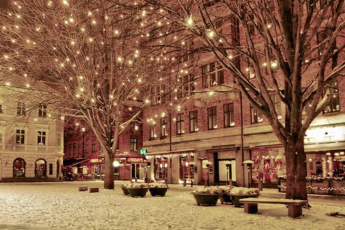 sprinkling snow twinkling over pink town