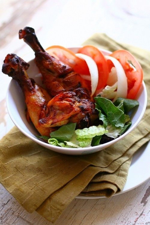 Tandoori Chicken -- The rich blend of spices gives the Tandoori Chicken its unique flavor but more importantly, it is the yogurt that helps to penetrate the spices into the meat and tenderize it at the same time.