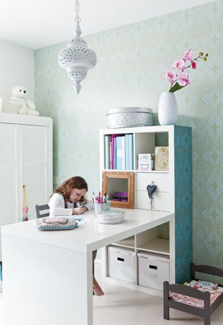 Girls bedroom with wallpaper feature wall and storage: