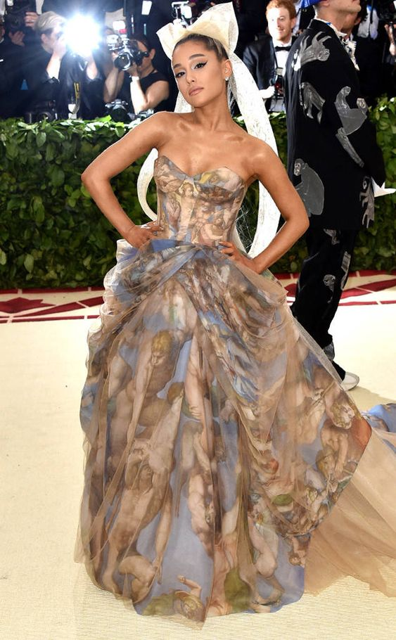 "Ariana Grande from Met Gala 2018: Best Dressed Stars to the Hit the Red Carpet The ""Side to Side"" singer was the Sistine Chapel incarnate."