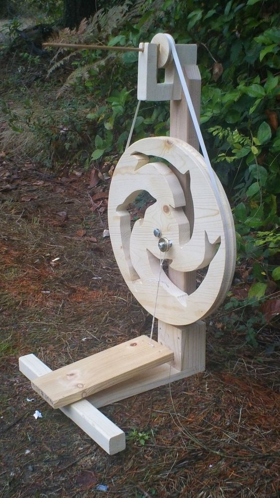 Dancing Dolphins Spindle Spinning Wheel.