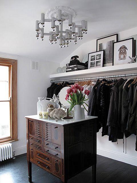 walk-in closet with antique style accent furniture #closet #storage #organization #allenrothCloset #allenAndRothCloset #closetShelves