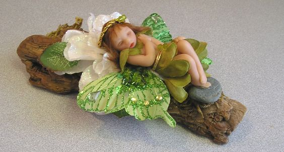 "Angel Fairy ""Breena"" Ooak hand sculpted miniature fairy one of a kind doll woodland scene. $45.00, via Etsy."