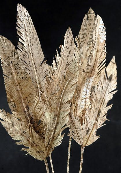 Paper feathers anyone? my father in law boufgt one n he pd $6! def making our own now lol