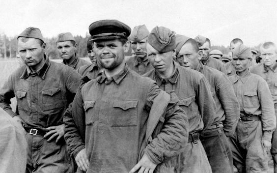 Downcast Soviet prisoners of the Germans - with the exception of the NCO who has found a mysterious cause for a smile. Statistically, only 10% of this group survived the war.