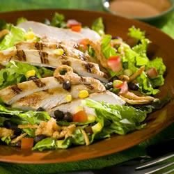 Slices of grilled chicken are tossed with lettuce and southwest-style ingredients, then served with a creamy barbeque sauce dressing.