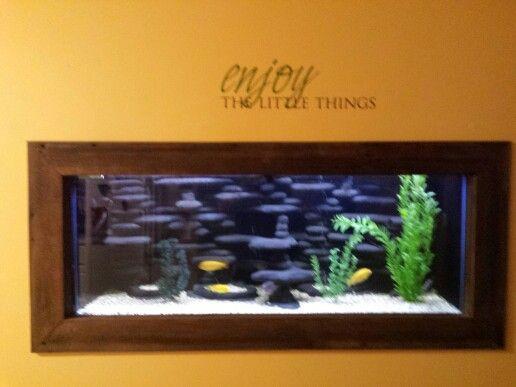 Wall aquarium with dramatic aquascape.