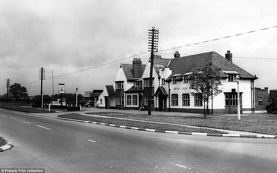 The Gretna Green Wedding Inn at Newton Aycliffe - a traditional pub and venue in County Durham - is pictured under dark skies in 1960