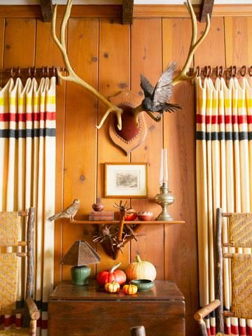 Take some cabin design tips from this quaint Michigan home charmingly decorated using Adirondack design principles and the owners' collections.